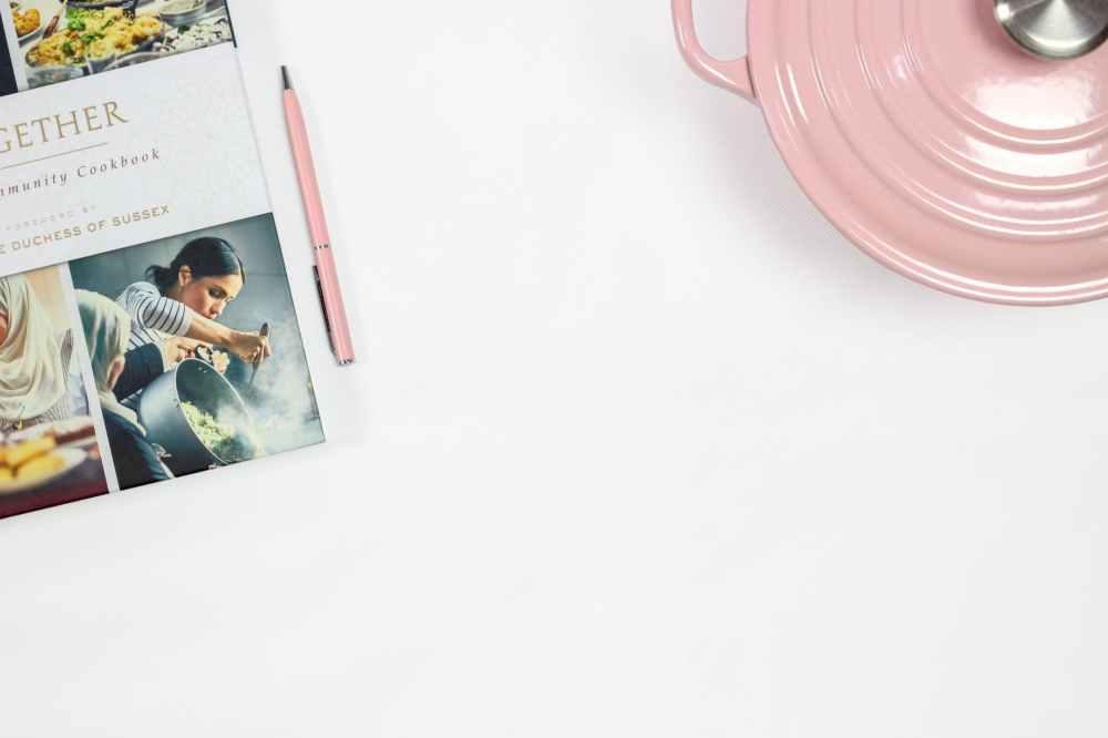 pink click pen near cooking pot